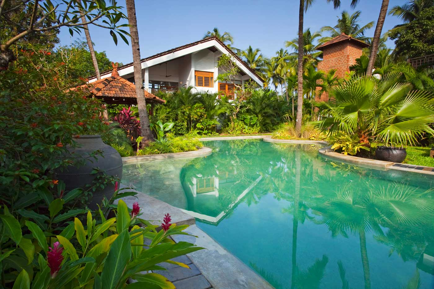 Luxury Villa - Ashvini, at Coco Shambhala lies closest to a very inviting free form swimming pool !